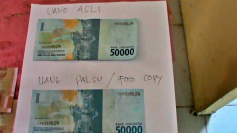 Ilustrasi uang palsu (Widori Agustino/iNews)