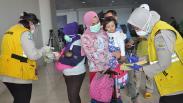 Tiba di Bandara Kualanamu, 134 TKI dari Malaysia Ikuti Proses Karantina