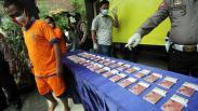 Polisi Amankan 2.459 Lembar Uang Palsu Pecahan Rp100.000 di Surabaya
