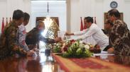 KPU Serahkan Laporan Penyelenggaraan Pemilu 2019 kepada Presiden Jokowi