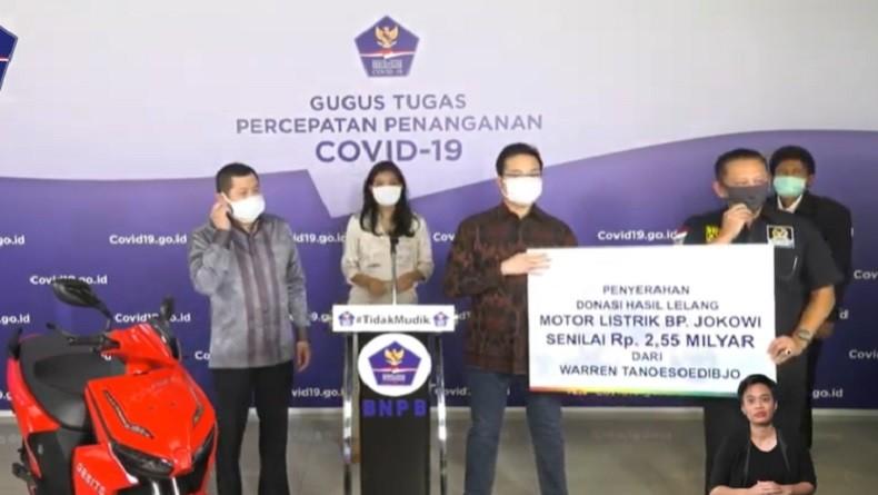 Motor Listrik Bertanda Tangan Jokowi Jadi Milik Warren Tanoesoedibjo
