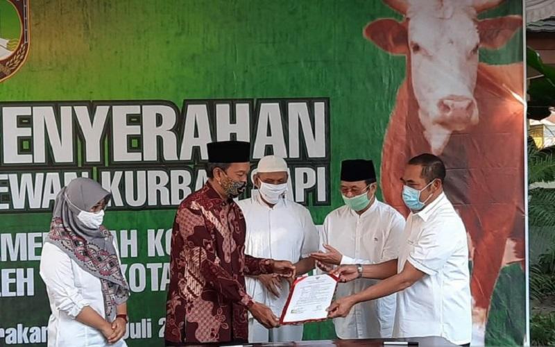 Sembuh dari Covid-19, Achmad Purnomo Serahkan Kurban dari Jokowi