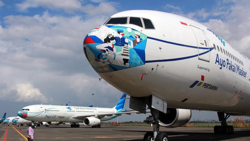 Penampakan Pesawat Garuda Indonesia Pakai Masker